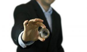 1281812_businessman_holding_crystal_globe